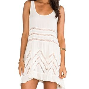 white dotted free people trapeze slip dress